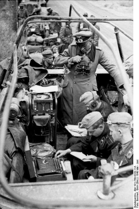 German General Heinz Guderian in a SdKfz. 251/3 halftrack vehicle, France, May 1940, photo 2 of 6; note Enigma machine
